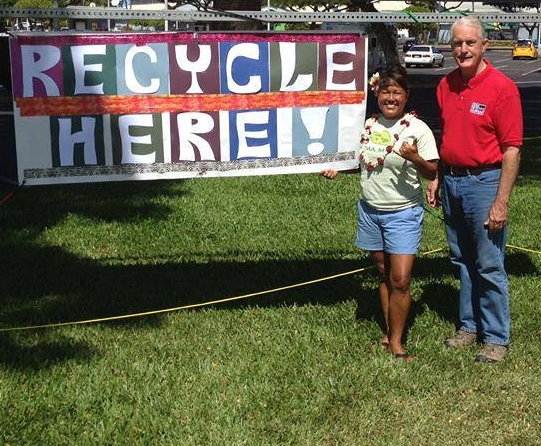Councilmembers Elle Cochran and Mike White at a recycling event. Rotary CLub of Lahaina Sunset photo.