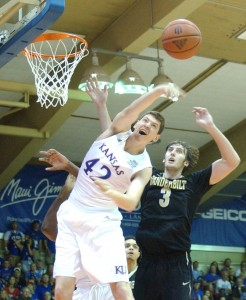 Kansas' Hunter Mickelson hoes up for a rebound against Vanderbilt's Luke Kornet. Photo by Joel B. Tamayo.