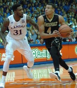 Vanderbilt's Wade Baldwin drives to the basket against Kansas' defender Jamari Traylor (31). Photo by Joel B. Tamayo.