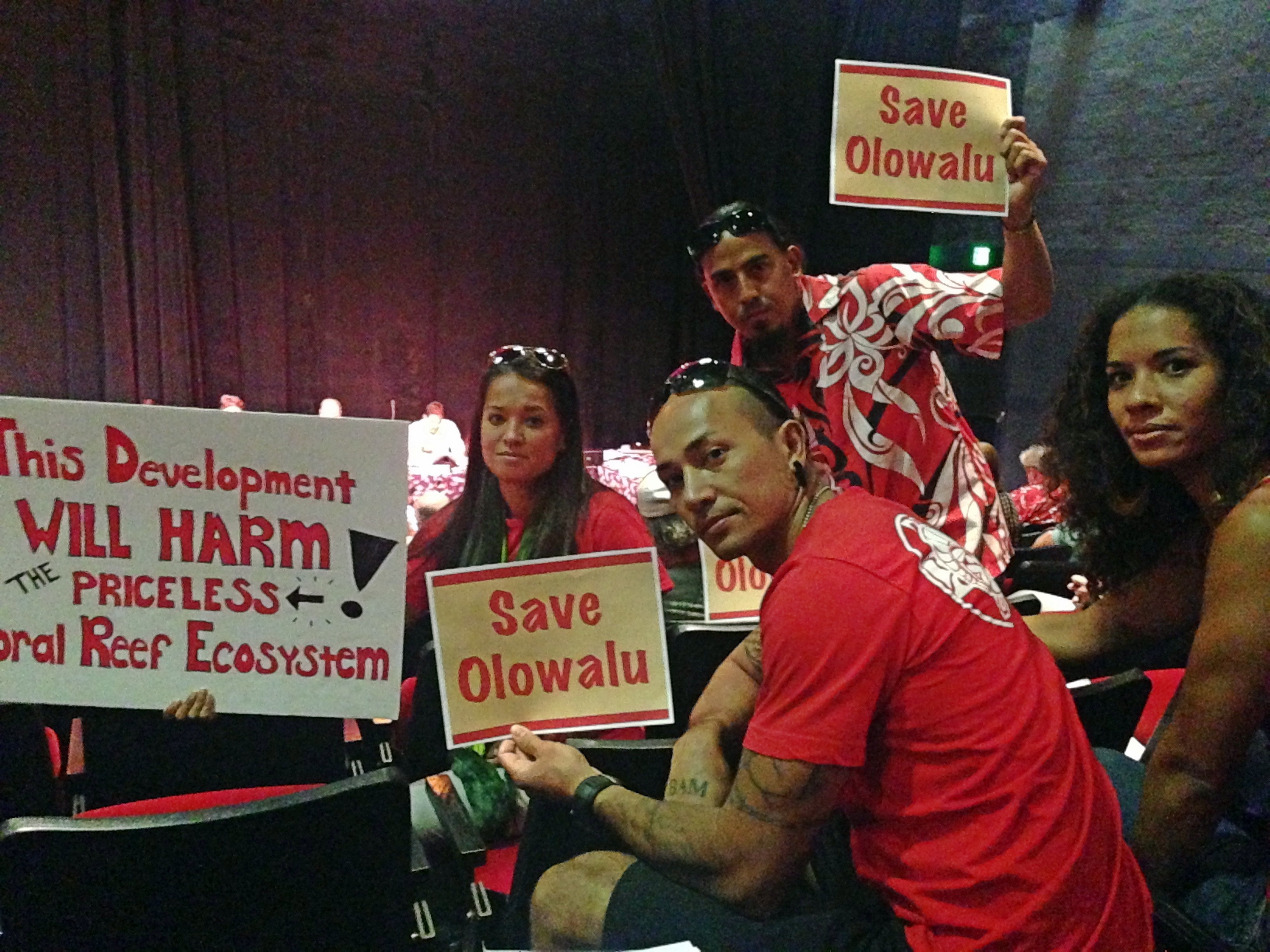 Lisa Marquis (from left), Peter deAquino, Davin Balagso and Kiana Carroll, all from Lahaina, came prepared both with signs and testimony against the Olowala Final Environmental Impact Statement. Debra Lordan photo.