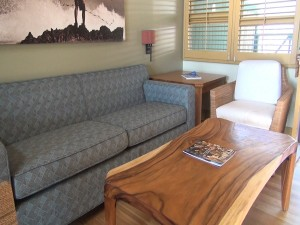 Couch and table in an ocean bungalow at Travaasa Hana. Photo by Kiaora Bohlool.