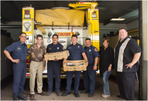 Mākena Beach & Golf Resort gives thanks to emergency service personnel this Thanksgiving, dropping off full prepared Thanksgiving feast to the firefighters of Wailuku Fire Station. (Photo Left to Right: Firefighter Leo Domingo, Mākena Beach & Golf Resort General Manager Declan McCarthy, Firefighter John Teves, Firefighter Seth Herrik, Captain Steven Thyne, Mākena Beach & Golf Resort Hotel Manager Denise Hoopai and Mākena Resort Director of Security Jason Klohs.)