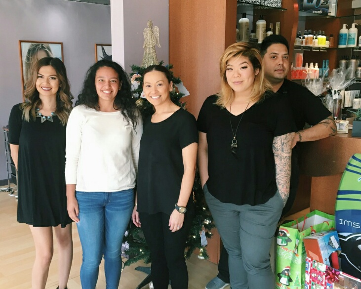 Makena Robinson and Colours Salon staff. Photo provided by Makena Robinson.