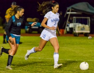 Baldwin's versatile Kainoa Dafun (5) works in the midfield as King Kekaulike's Darian Fernandez defends, during first-half action Friday. Photo by Rodney S. Yap.
