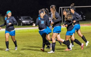 King Kekaulike's Erynn Duquette (16) congratulates teammate Darian Fernandez after she scored Na Alii's second goal to trim Baldwin's lead to 3-2 in the first half. Photo by Rodney S. Yap.