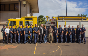 Mākena Beach & Resort's General Manager Declan McCarthy, Hotel Manager Denise Hoopai and Director of Security Jason Klohs poses with the Kahului Fire Department Team, after dropping off a fully prepared Thanksgiving meal for the entire firehouse.