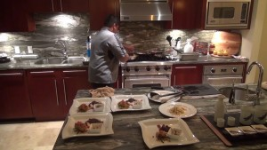 Private chef Allain de Leon of gotchefmaui.com prepares a meal in a Honua Kai suite. Photo by Kiaora Bohlool.