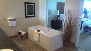 Bathroom and bedroom in a Honua Kai suite. Photo by Kiaora Bohlool.