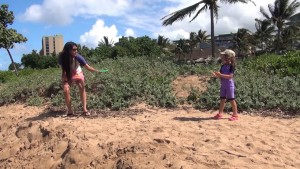 Playing frisbee on the beach outside Honua Kai Resort & Spa in Kā'anapali. Photo by Kiaora Bohlool.
