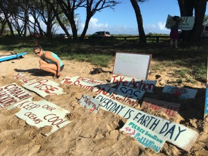 Lauren Blickley with volunteer-made signs before the paddle out.