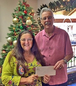 Wailea Community Association's General Manager, Bud Pikrone, presented checks totaling around $6,600 to Marlene Rice, Development Director for the Maui Food Bank.  Courtesy photo.