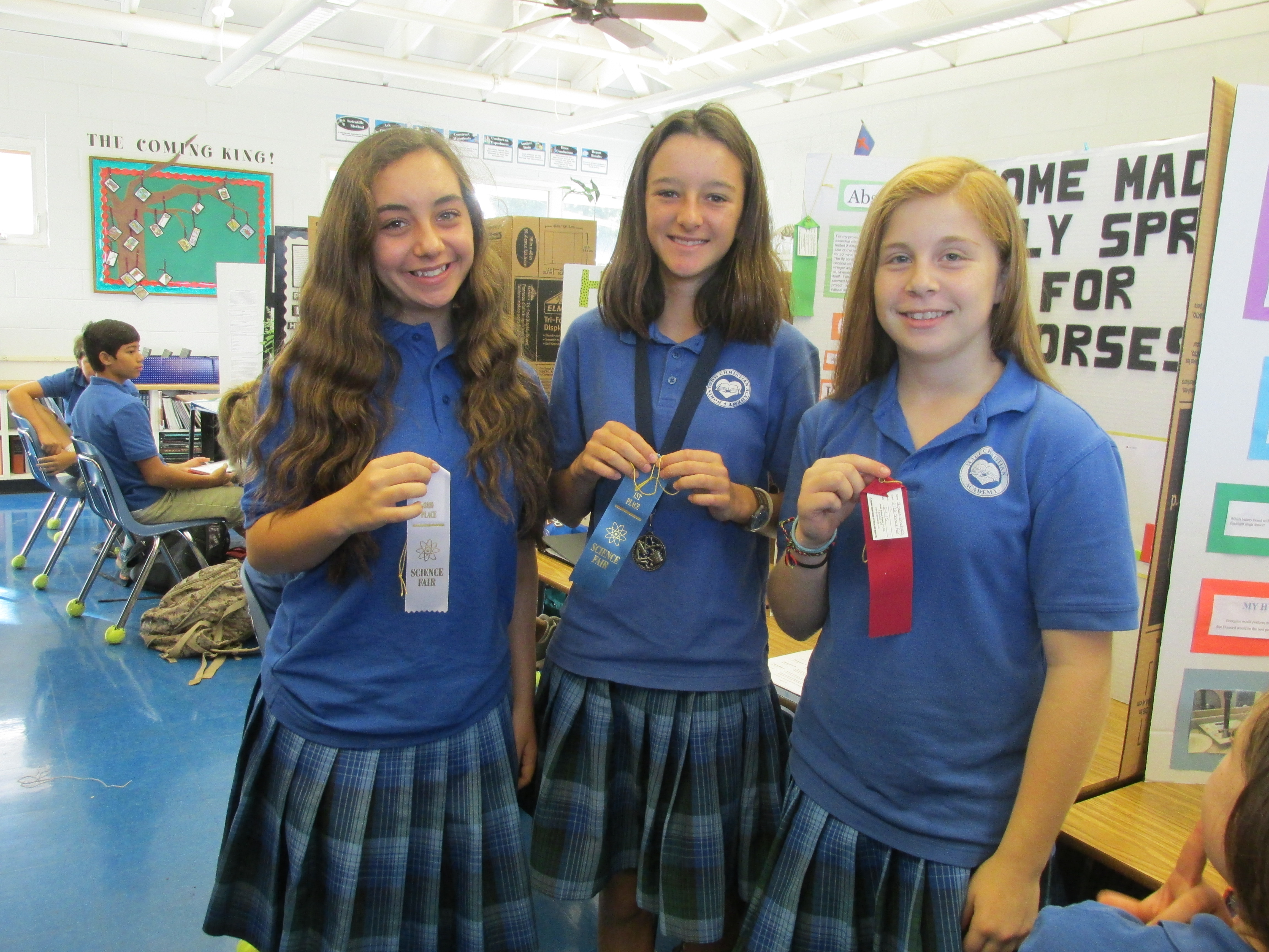 Doris Todd Science Fairseventhgrade winners(left to right): Natalie Boody, second place; Keala Bouwens, first place and grand champion; and Stephanie Reisdorph, thirdplace.