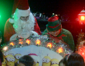 Santa and his elves give the keiki a ride
