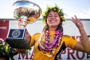 Carissa Moore (HAW), the three-time WSL Champion, all smiles after capping off an incredible 2015 season with a Target Maui Pro win. (PRNewsFoto/World Surf League)