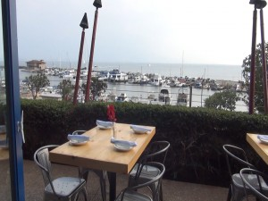 Outdoor dining with ocean views at Oceanside. Photo by Kiaora Bohlool.