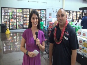Kiaora Bohlool interviews Island Grocery Depot assistant manager Russell Romo.