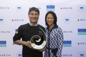 """Hawai'i Food & Wine Festival co-chair Chef Roy Yamaguchi and executive director Denise Yamaguchi accept the Charitable award at FestForward's """"Best of the Fests"""" ceremony in Santa Barbara, California.  Courtesy photo."""