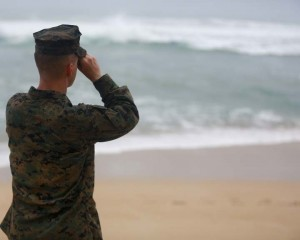 A Marine Officer attached to Marine Heavy Helicopter Squadron 463 uses binoculars to search for debris of a helicopter mishap in Haleiwa Beach Park, Jan. 15, 2016. The mission of Marine Corps Base Hawaii is to provide facilities, programs and services in direct support of units, individuals and families in order to enhance and sustain combat readiness for all operating forces and tenant organizations aboard MCB Hawaii. (U.S. Marine Corps photo by Cpl. Ricky S. Gomez/ Released)
