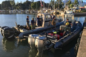 Members of the Navy's Mobile Diving Salvage Unit-1, Joint Base Pearl Harbor, Hickam, Hawaii, make preparations at Haleiwa, Hawaii, to continue operations during the fourth day of the search the 12 missing Marines on Jan. 19, 2016. The operation is part of the joint rescue effort following the mishap involving two Marine Corps CH-53E Super Stallion helicopters the night of Jan. 14, 2016. (U.S. Coast Guard photo by Lt. Kevin Cooper/Released)