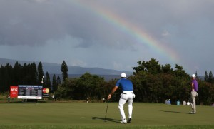 PGA golfers Jason Day and Justin Thomas putt on the third hole with a rainbow behind them during the third round of the Hyundai Tournament of Champions golf tournament at Kapalua Resort of Saturday. Photo by Brian Spurlock of USA TODAY Sports.