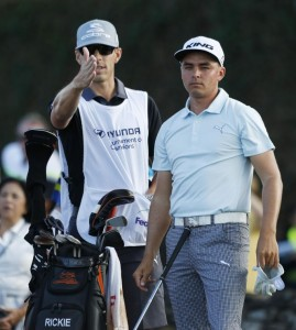 PGA golfer Rickie Fowler talks to his caddie before teeing off on the first hole during the third round of the Hyundai Tournament of Champions golf tournament at Kapalua Resort on Saturday. Photo by Brian Spurlock of USA TODAY Sports.