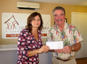 HomeStreet Bank Loan Officer Lisa Carillo presents a check for $5,000 to Na Hale O Maui Executive Director John Andersen to support the Community Land Trust's Homebuyers' Assistance Program.