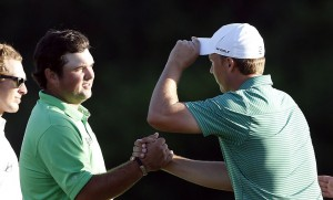 PGA golfer Patrick Reed (left) shakes hands with Jordan Spieth after finishing on the 18th green during the first round of the Hyundai Tournament of Champions golf tournament at Kapalua Resort on Thursday. Photo by Brian Spurlock of USA TODAY Sports.