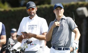 PGA golfer Jordan Spieth waits with his caddie Mike Greller before teeing off on the first hole during the second round of the Hyundai Tournament of Champions golf tournament at Kapalua Resort on Friday. Photo by Brian Spurlock of USA TODAY Sports.