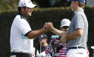 PGA golfer Patrick Reed shakes hands on the first tee with Jordan Spieth during the second round of the Hyundai Tournament of Champions golf tournament at The Plantation Course. on Friday. Photo by Brian Spurlock of USA TODAY Sports.