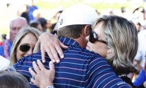 PGA golfer Jordan Spieth gets a hug from his mom after winning the Hyundai Tournament of Champions golf tournament at Kapalua Resort on Sunday. Photo by Brian Spurlock of USA TODAY Sports.