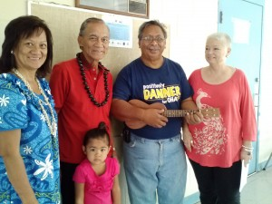 Ewalina Mariano (from left) again co-chairs the Prince Kuhio Day celebration and seeks vendors for the daylong event March 26 at Paukukalo homestead. She is shown with Paukukalo residents Ernest Valle, his 4-year-old granddaughter Challyse-Fe Valle and Matthew Kailihou, and community/informational booth participant Anne Chipchase of Project Vision Hawai'i. Photo credit: Kekoa Enomoto.