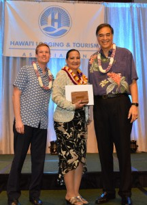 (Left to right) Ben Rafter, HLTA chairperson); Emily Arcangel, 2016 Outstanding Lodging Employee of the Year; and Mufi Hannemann, HLTA president and CEO. HLTA photo.