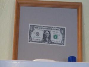 Dollar posted on the wall at Maui Pasta Company. Photo by Kiaora Bohlool.