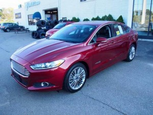 Stolen: Jan. 31, 2016 from a home in Pāʻia. 2013 RED Ford Fusion HYBRID. Other identifying characteristics: *long scrape across the passenger side; *shell necklace hanging from review mirror. License: (Hawaii plates) LDR 823. Police Report: 16-004451.
