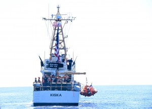 USCGC Kiska (WPB 1336) recovers their small boat while off Maui in the Hawaiian Islands Humpback Whale National Marine Sanctuary, Feb. 11, 2016, during Operation Kohola Guardian. Coast Guard members from Station Maui and the Kiska and officers from the Hawaii Department of Land and Natural Resources conducted safety and compliance boardings on recreational and commercial vessels to inform the public of the requirements to avoid coming too close to whales or impeding the whales' path. (U.S. Coast Guard photo by Chief Petty Officer Sara Mooers/Released)