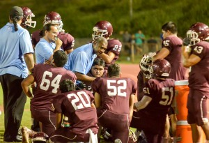 Former Baldwin defensive coordinator Jack Damuni talks to the defense during a time out last season at War Memorial Stadium. File photo by Rodney S. Yap.