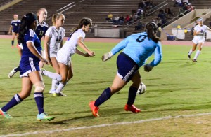 Seabury Hall's Jenna Carvalho (6) gets ready to score the Spartans' first goal Wednesday's after her initial shot attempt on goal was blocked by St. Anthony's goal keeper. Seabury Hall won 2-1. Photo by Rodney S. Yap.
