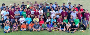 The Wailuku Big Boyz players and coaches pose with Jack Damuni (middle) on his last day of practice, Feb. 5, at the Pit Field. Photo by Rodney S. Yap.