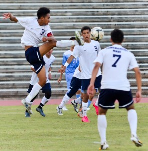 Kamehameha Maui's Kaisyn Lee (3) goes up high for a ball between teammates Nainoa Silva (7) and Kekoa Ostermiller (9) on Friday against Baldwin at War Memorial Stadium. Photo by Rodney S. Yap.
