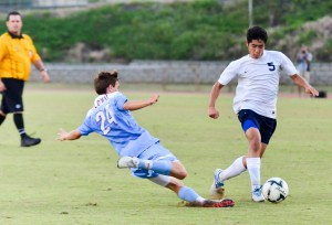 Kamehameha Maui's Jake Mateaki (5) tries to dribble to past Baldwin defender Hayden Hawes during second-half action Friday at War Memorial Stadium. Photo by Rodney S. Yap.