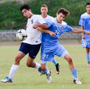 Kamehameha Maui's Jake Mateaki (5) battles for a ball with Baldwin's Hayden Hawes (24) during second-half action Friday at War Memorial Stadium. Photo by Rodney S. Yap.