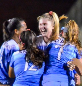Baldwin's Skylar Littlefield is mobbed by her teammates Friday after scoring the game's only goal in the 78th minute. Photo by Rodney S. Yap.