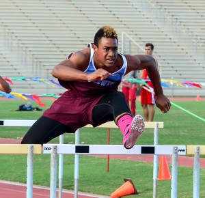 Baldwin High School's Laakea Kahoohanohano-Davis en route to winning the boys 110-meter high hurdles Friday. Photo (Feb. 2016) by Rodney S. Yap.
