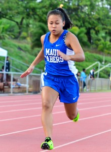 Maui High girls sprinter in the 100-meter dash. Photo by Rodney S. Yap.