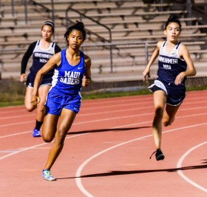 Maui High's Alyssa Mae Antolin and Kamehameha Maui's Ani Nitta finished 1-2 in their heat of the girls 200 Friday. Antolin's time of 26.01 was the fastest in the girls division. Photo by Rodney S. Yap.