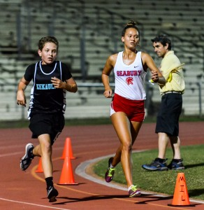 Seabury Hall's Ava Shipman won the girls 800 and 3000. King Kekaulike junior varsity winner in the 3000, Joseph Musto, ran with Shipman for a couple laps late in the race. Shipman was timed in 11:31.23 compared to Musto's 11:57.91. Photo by Rodney S. Yap.