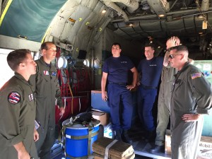 A Coast Guard HC-130 Hercules airplane crew conducts a pre-flight brief prior to launching from Air Station Barbers Point in response to a report of 40 people abandoning ship south of the Hawaiian Islands, Feb. 10, 2016. (U.S. Coast Guard photo by Lt. Sarah Bradley)
