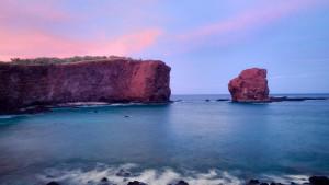 Puʻu Pehe, or Sweetheart Rock, at sunset on Lānaʻi.  Photo courtesy of Four Seasons Resort Lānaʻi.