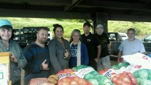 Kahikinui residents receiving donations from the Maui Job Corps.