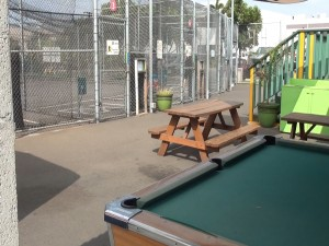 Pool table and batting cages at Hitter's Paradise. Photo by Kiaora Bohlool.
